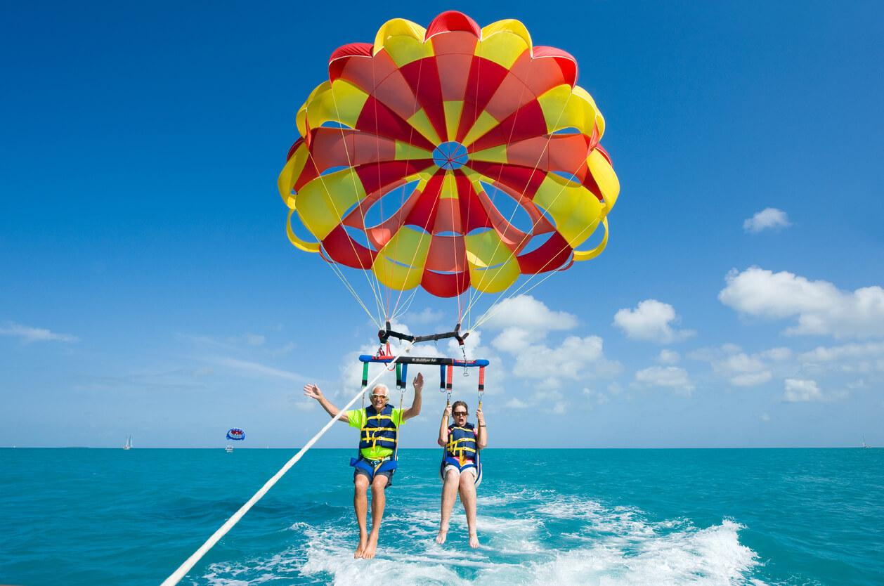 Elderly couple enjoying parasailing in Dubai